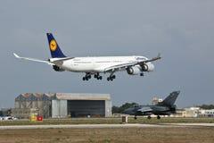 皇家空军龙卷风和汉莎航空公司A340 库存图片