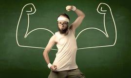 皮包骨头的学生想要肌肉 免版税库存照片