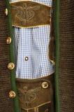 皮短裤和悬挂装置 免版税库存图片