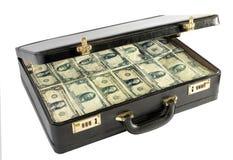 黑皮革公文包包装与金钱 免版税图库摄影