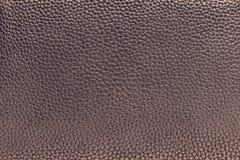 皮革材料淡紫色黑暗的纹理  免版税库存图片