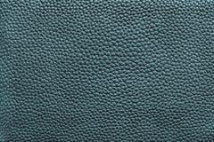 皮革材料蓝绿色黑暗的纹理  免版税图库摄影