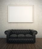 黑皮革沙发 免版税库存照片