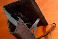 黑皮革烟丝袋 库存图片