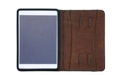 皮革盒盖的片剂隔绝在白色 免版税图库摄影