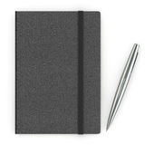 黑皮革笔记本和一支银色笔 图库摄影