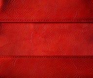 皮革螺纹缝背景,红色缝了衣物纹理 库存图片