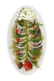 盐味的鲱鱼用葱 免版税库存图片