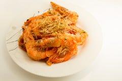 盐和胡椒虾在白色背景中 免版税图库摄影