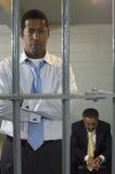 监狱牢房的两个人 免版税库存照片