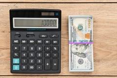 盒美元和计算器 免版税库存图片