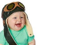 盔甲飞行员的逗人喜爱的小男孩 免版税库存图片