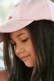 盖帽儿童桃红色佩带 免版税库存照片
