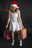 盖帽圣诞节女孩采购上升了 库存照片