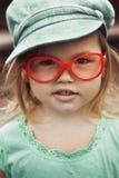 盖帽女孩玻璃红色的一点 免版税库存照片