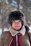 盖帽毛皮成熟佩带的妇女 库存图片