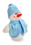 盖帽穿戴了围巾微笑的雪人玩具 免版税库存照片