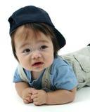 盖帽逗人喜爱的小孩 免版税库存照片