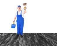 盖无形的墙壁的房屋油漆工 免版税库存照片