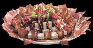 满盘在黑背景隔绝的开胃菜美味盘 图库摄影