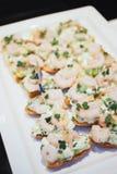 盘子用各种各样的可口开胃菜 免版税库存图片