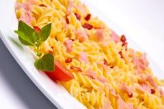 盘意大利面食蕃茄 免版税图库摄影