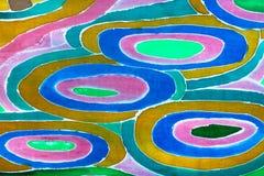 盘旋在丝绸围巾的样式在蜡染布技术 免版税库存图片