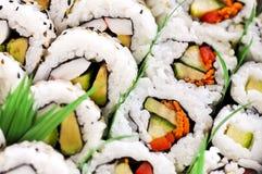 盛肉盘寿司 库存照片