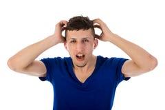 目瞪口呆的人用在头发的手 库存照片