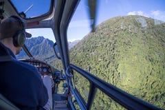 直升机乘驾的冒险图象对福克斯冰川,新西兰的 库存照片
