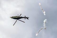 直升机奥古斯塔A-109和火光 免版税库存图片