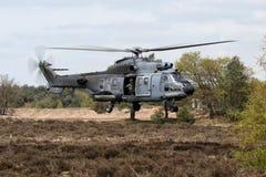 直升机盘旋的军人 免版税图库摄影
