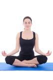 相当一个冥想的瑜伽姿势的少妇 库存照片