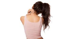 相当亚裔女孩有脖子痛 免版税库存照片