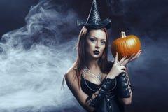 相当作为神仙打扮的年轻红头发人妇女 图库摄影