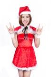 相当圣诞老人服装的亚裔女孩在白色backgr的圣诞节的 免版税图库摄影