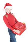 相当圣诞老人辅助工帽子的十几岁的女孩 库存图片