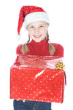 相当圣诞老人辅助工帽子的十几岁的女孩 免版税图库摄影