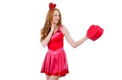 相当在拿着礼物的微型桃红色礼服的年轻模型 免版税库存照片