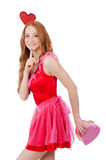 相当在拿着礼物的微型桃红色礼服的年轻模型 免版税库存图片
