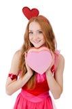 相当在拿着礼物的微型桃红色礼服的年轻模型 库存照片