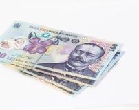 相当在白色背景隔绝的100罗马尼亚列伊价值的四张钞票 库存图片