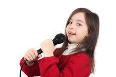 相当小女孩唱歌 免版税库存照片