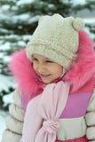 相当小女孩在冬天 免版税库存图片