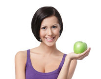 相当小姐用绿色苹果 库存图片