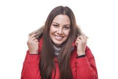 相当微笑在红色夹克 免版税库存图片