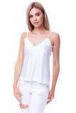 相当性感的夫人美丽的妇女衣裳佩带时髦的白色deni 库存照片