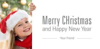 相当有圣诞老人帽子和红色橡皮奶嘴藏品的金发女孩 库存图片