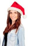 相当有圣诞节帽子的女孩 免版税库存图片