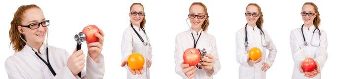 相当有在whi和桔子的女性医生隔绝的听诊器 免版税库存图片